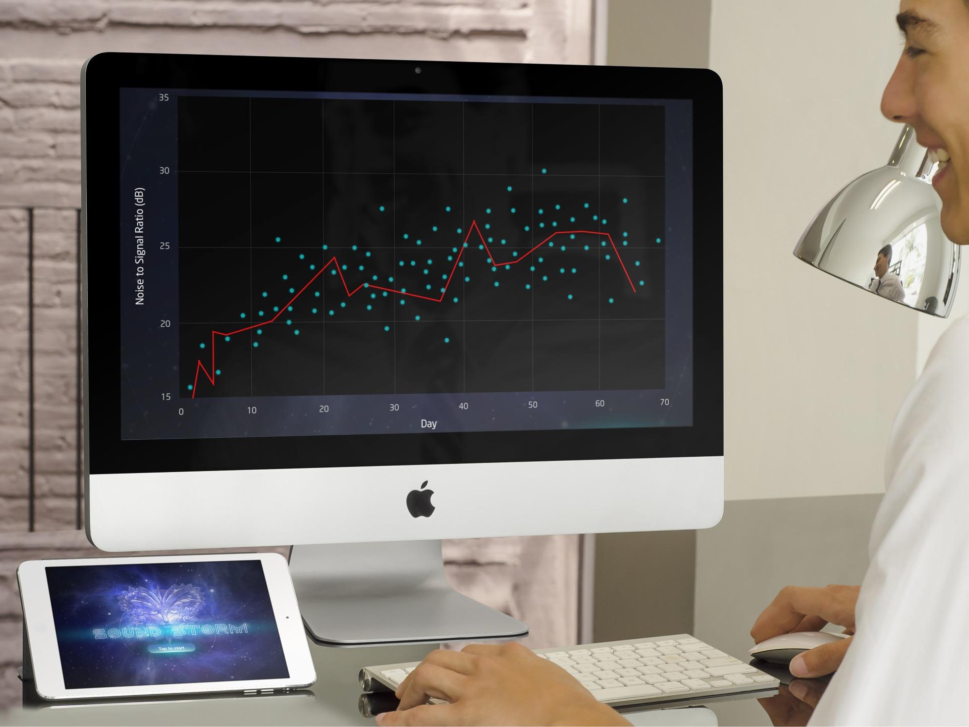 Audiologist reviewing patient progress
